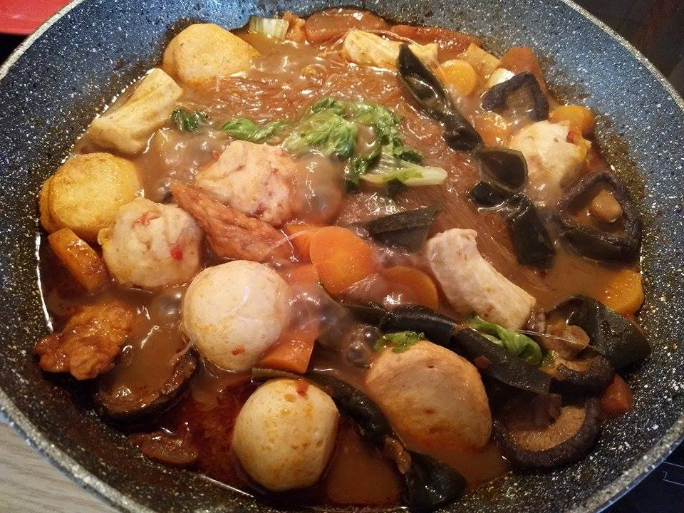 Hot pot with a lot of ingredients